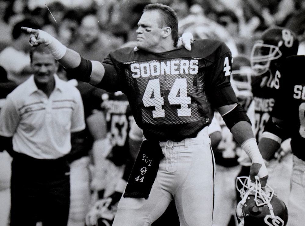 Bosworth stirring up the pot before the Miami game as legendary coach Barry Switzer looks on in the background.