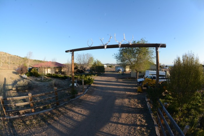 The entrance to their ranch is adorned with Elk skulls.