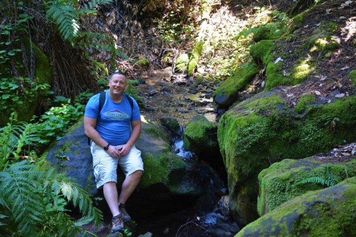 Pause for a photo at a small, trickling stream.