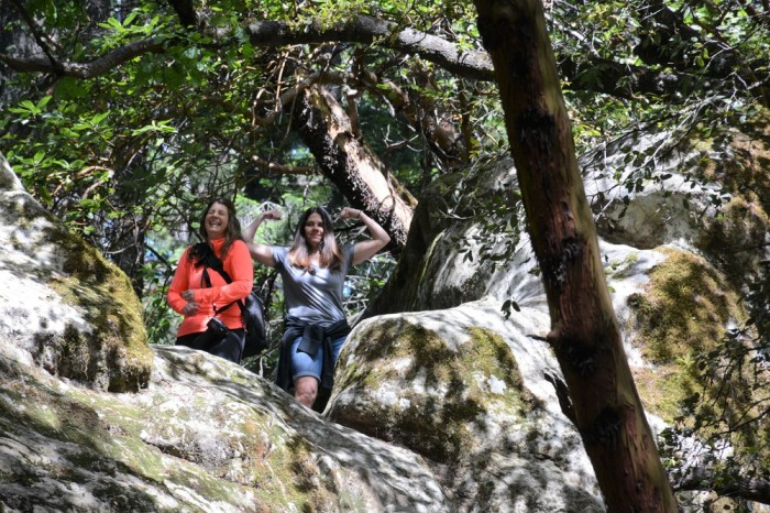My companions for the hike, Lori and Julie, ham it up on top of the big boulder at the beginning of the trail.