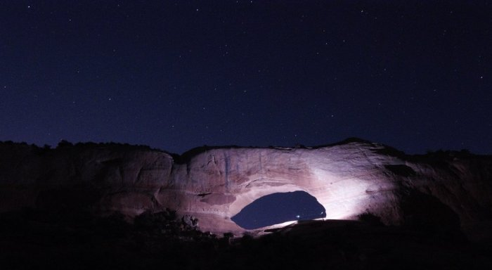 This photo was about a 30 second exposure with the added light around the arch provided by another photographer who happened to be there at the same time as us. If you look carefully, you can see where the photographer is in the photo.