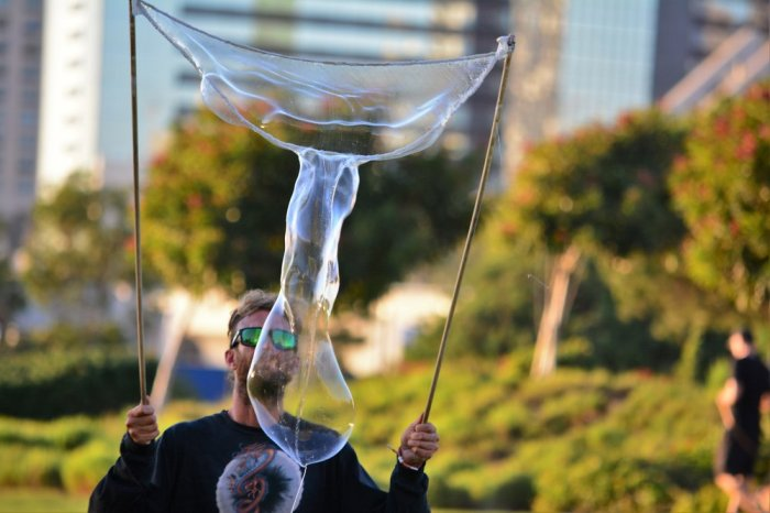 This man was making huge bubbles on the waterfront.